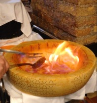Cognac is poured into the cheese wheel, lit up, and then it melts a cheese jacuzzi for the pasta.